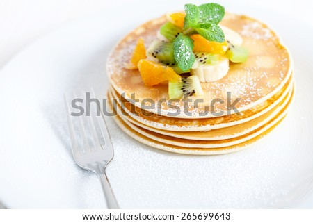delicious pancakes with fruits