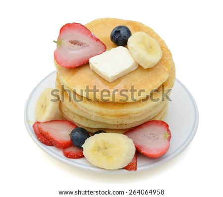 delicious pancakes with fruits on plate isolated on white  - stock photo