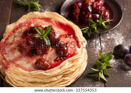 delicious pancakes with homemade fresh plum`s confiture