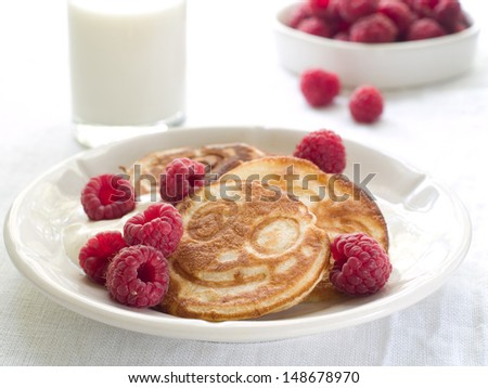 Delicious pancakes with raspberries, selective focus