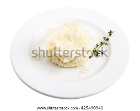 Delicious parmesan risotto with white wine. Isolated on a white background. - stock photo