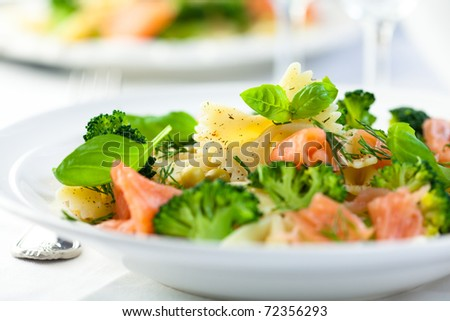 Delicious pasta salad with salmon,broccoli and fresh herbs