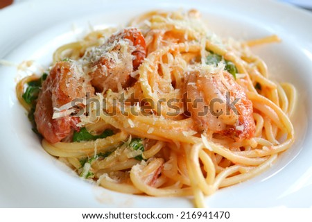 Delicious pasta spaghetti with shrimps and other seafood - stock photo