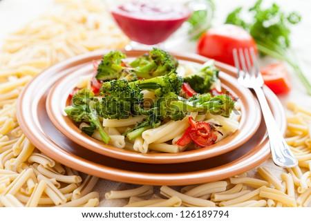 Delicious pasta with bro������oli. Selective focus. Tasty italian food - stock photo
