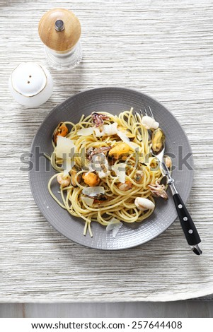 Delicious pasta with seafood on a plate, food - stock photo
