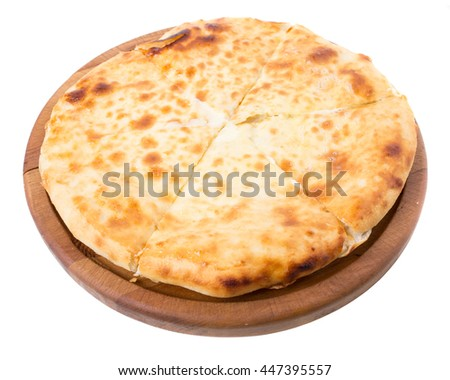 Delicious pie stuffed with lamb meat. Isolated on a white background.