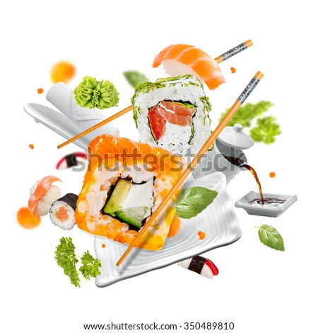 Delicious pieces of sushi, isolated on white background - stock photo