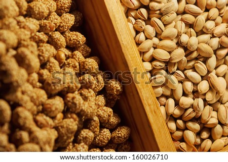 Delicious pistachios and peanuts/Pistachio and sweet peanuts on market place. Arranged in rows. Healthy food. - stock photo