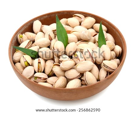 delicious pistachios in bowl on white background  - stock photo
