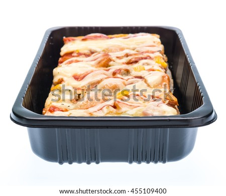 Delicious pizza in packaging isolated on white background - stock photo