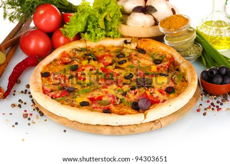 delicious pizza on wooden board, vegetables, spices and oil isolated on white