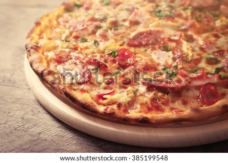 Delicious pizza on wooden table, close up - stock photo