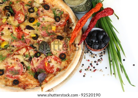 delicious pizza, vegetables and spices  isolated on white - stock photo