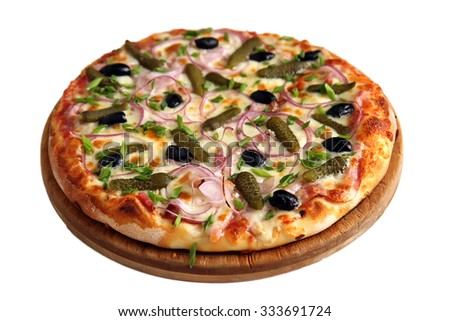 Delicious pizza with cornichons, salad onion, bacon, black olives on wooden stand isolated on white