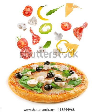 Delicious pizza with falling ingredients, isolated on white - stock photo