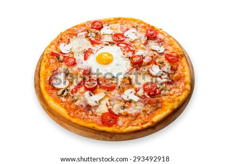 Delicious pizza with mushrooms, bacon, cherry tomatoes and egg - thin pastry crust at white background on wooden desk - stock photo