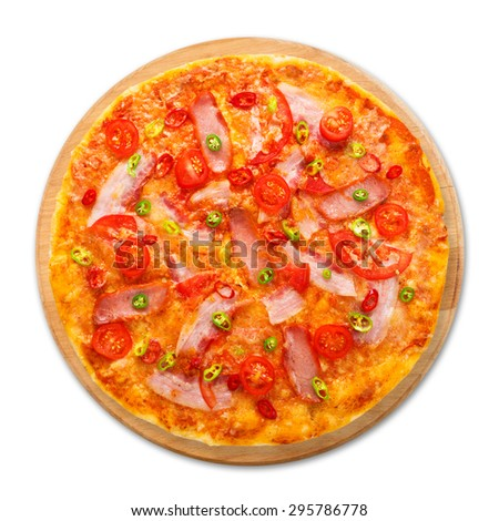 Delicious pizza with red and green hot chili peppers, bacon and cherry tomatoes - thin pastry crust at white background on wooden desk above view - stock photo