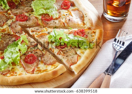Delicious pizza with salad leaves and bacon. Close-up view