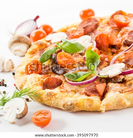 delicious pizza with tomatoes, bacon and mushrooms on a white background