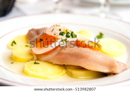 delicious plate of fish and potatoes