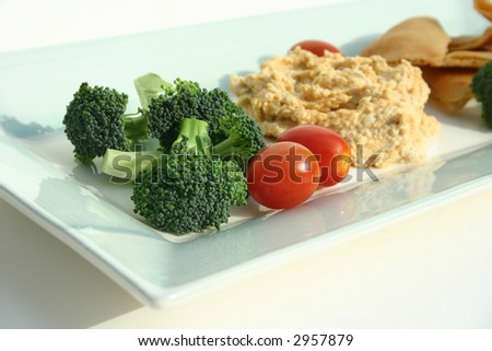 Delicious Plate of Hummus and Vegetables Isolated on White