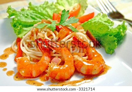 delicious plate of pasta with prawns - stock photo