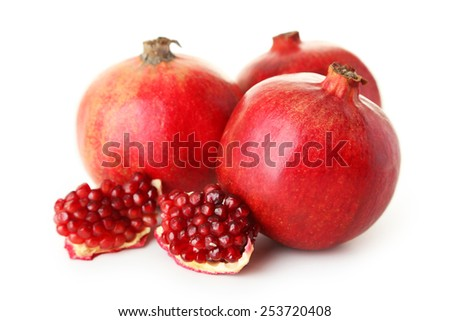 Delicious pomegranate fruit isolated on white - stock photo