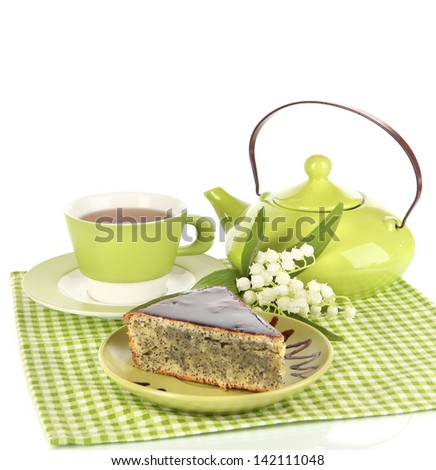 Delicious poppy seed cake with cup of tea isolated on white