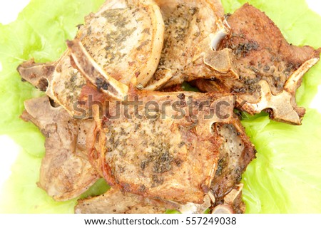 Delicious pork chops seasoned with butter melted cilantro and lemon juice