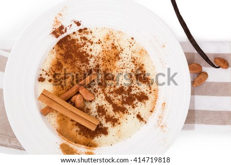 Delicious porridge breakfast with cinnamon and cocoa powder. Traditional breakfast eating.  - stock photo