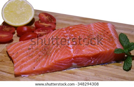 Delicious portion of fresh salmon fillet with spices and vegetables - healthy food, diet or cooking concept