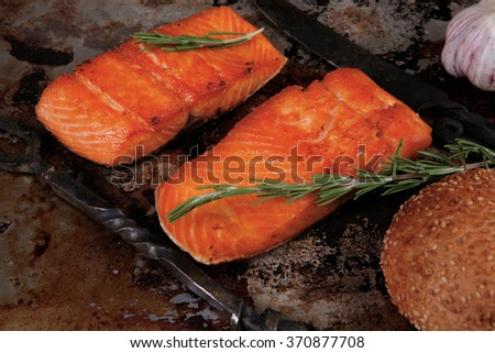 delicious portion of raw fresh salmon fillet with aromatic herbs and spices on vintage tray over wooden table - healthy food, diet cooking concept