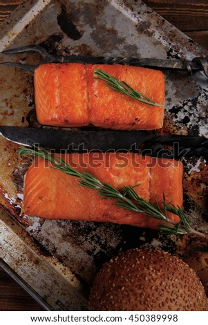 delicious portion of raw fresh salmon fillet with aromatic herbs and spices on vintage tray over wooden table - healthy food, diet cooking concept  - stock photo