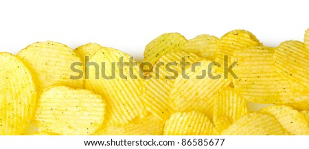 Delicious potato chips isolated on white