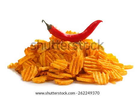 Delicious potato chips with  chili pepper isolated on white - stock photo