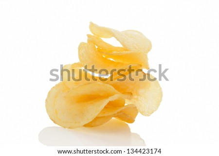 Delicious potatoes chips isolated on white background. Unhealthy eating.
