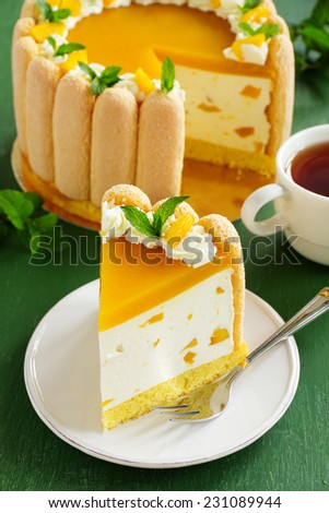 """Delicious pound cake """"Charlotte"""" with mango and peaches. - stock photo"""