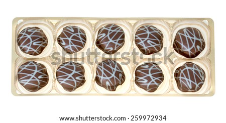 delicious pralines in a box isolated over a white background / Pralines - stock photo