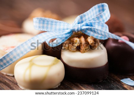 delicious pralines with a decorative bow - stock photo
