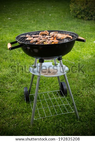 Delicious prawn on grill with flames in background - stock photo