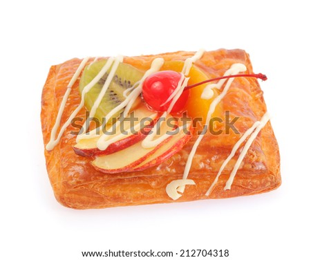 Delicious puff pastry with cream and fruits isolated on white background