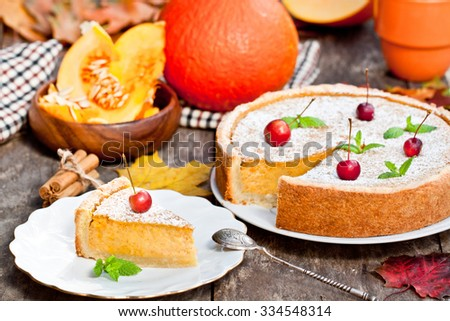 Delicious pumpkin pie  with cinnamon decorated with wild apples  - stock photo
