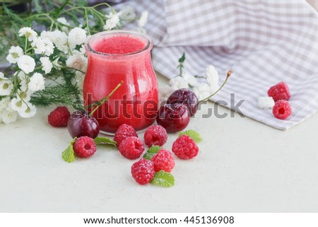 Delicious raspberry and sweet cherry smoothie or milk shake with fresh berries. Fresh yogurt with raspberry. Healthy breakfast.