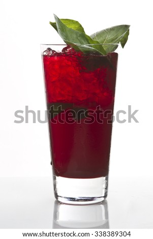 delicious red cocktail in high ball glass. tasty long drink on white background with reflection - stock photo