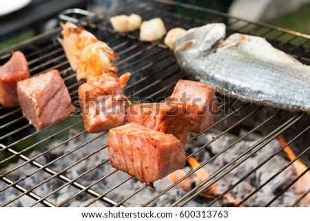 Delicious red fish being cooked on grill