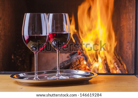 delicious red wine at fireplace - stock photo