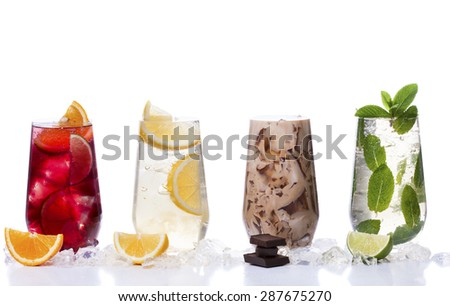 delicious refreshing summer drinks . Sangria , lemonade, iced chocolate drink , a mojito on a white background . Ice cubes around glasses with drinks . Natural collage of beverages - stock photo