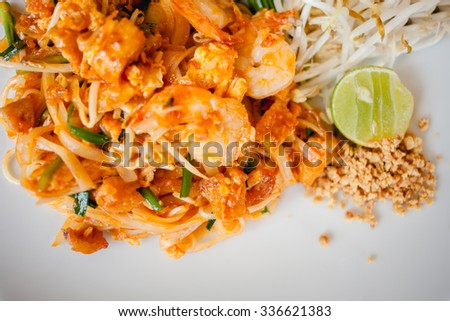 Delicious rice noodles with shrimp close-up on a plate. horizontal