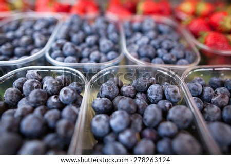 Delicious, ripe and fresh blueberries and strawberries - stock photo