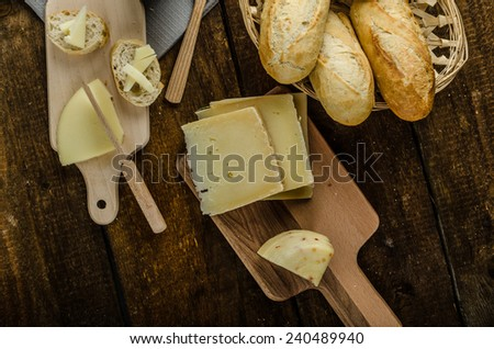 Delicious ripe cheese with crispy baguette and wine, wood board - stock photo